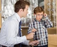optician with boy training